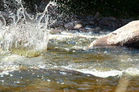 Splash of water from falling stone 版權商用圖片