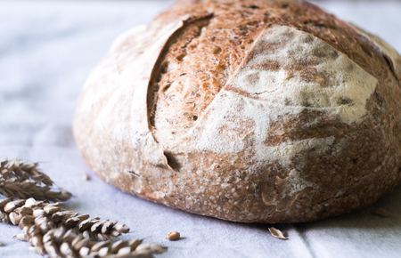Close-up of fresh sourdough artisan bread on kitchen towel Stock Photo