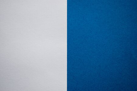 White and blue abstract background divided vertically