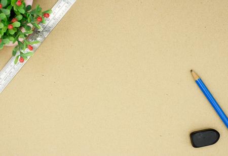 office stapler: Flower and pen on brown paper