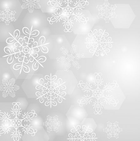 Grey winter background with snowflakes