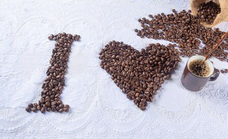 coffee beans forming drawings and phrases for those who love coffee.