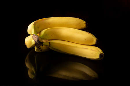 Bananas, arrangement with bananas on reflective surface, selective focus.