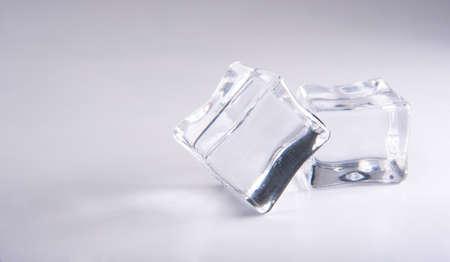 Acrylic cubes imitating ice on white surface, selective focus. Stock Photo