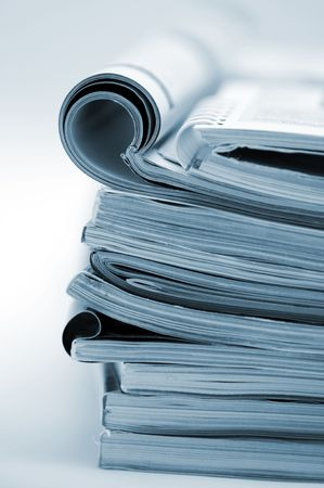 periodical: Stack of magazines in blue toned