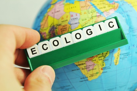 ecologists: Ecologic concept with message on game board and Earth globe in background