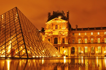 Paris, France - March, 2011: Night view of Louvre Museum with the famous glass pyramid, the main touristic attraction in Paris and one of the most visited landmarks around the world Editorial