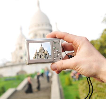 taking photograph: Tourist in Paris