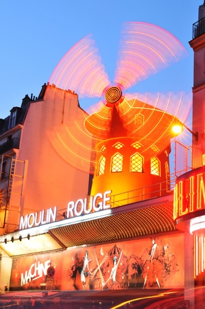 Paris, France - 28th March, 2011. Night view of Moulin Rouge in Montmartre district, a well-known cabaret built in 1889 and one of the most famous touristic attractions in Paris nowadays.  Stock Photo - 10484573