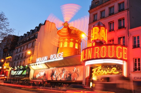 Paris, France - 28th March, 2011. Night view of Moulin Rouge in Montmartre district, a well-known cabaret built in 1889 and one of the most famous touristic attractions in Paris nowadays.  Editorial
