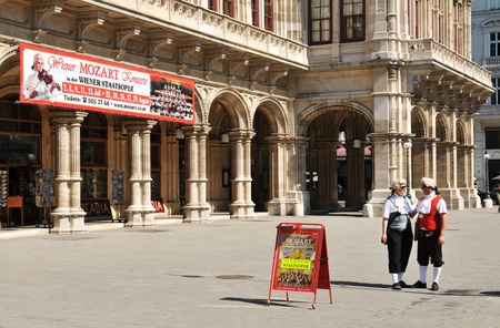 heralds: Vienna, Austria - July 10, 2011 - Medieval herald advertising the concert in front of Viennese Opera.
