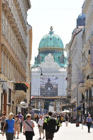 Vienna, Austria - July 10, 2011: Tourists visiting the historical center of Vienna. The famous Hofburg Palace in the background, one of the most important landmarks in Vienna, Austria