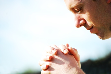 prayer: Man praying  Stock Photo