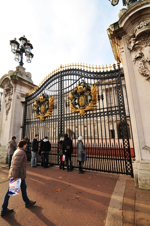 London, UK - 18 Nov, 2011: Tourists visiting Buckingham Palace in London