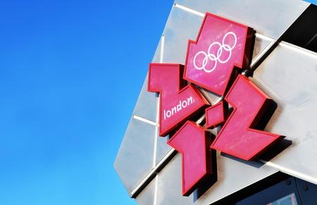 trafalgar: London, UK - 18 Nov, 2011: Official 2012 London Olympics logo against blue sky in Trafalgar Square, London  Editorial
