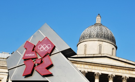 olympic symbol: London, UK - 18 Nov, 2011: London Olympics 2012 official logo against the old architecture of National Gallery in Trafalgar Square  Editorial