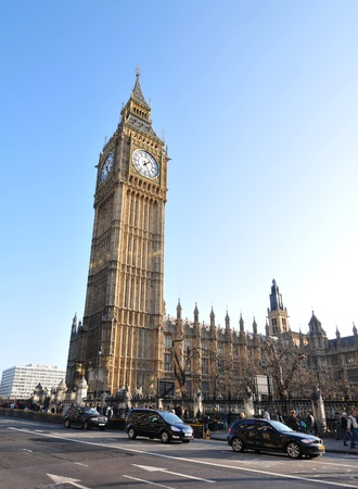 taxi famous building: London, UK - 19 Nov, 2011: Big Ben is one of the most well-known landmarks in the world situated at the north end of the Palace of Westminster in London Editorial