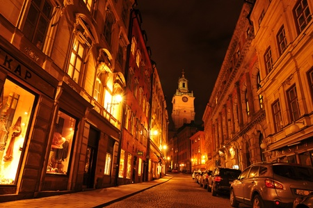 scandinavian people: Stockholm, Sweden - 12 Dec 2011: Night view of street in Gamla Stan, the old town of Stockholm with Storkyrkan (Church of St. Nicholas) in the background
