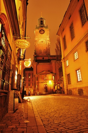 Stockholm, Sweden - 12 Dec 2011: Night view of street in Gamla Stan, the old town of Stockholm with Storkyrkan (Church of St. Nicholas) in the background Stock Photo - 12001521