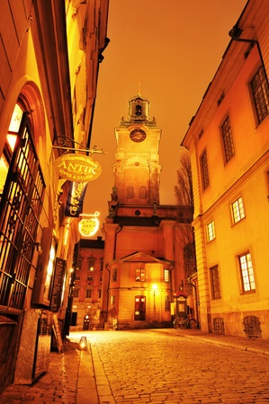 Stockholm, Sweden - 12 Dec 2011: Night view of street in Gamla Stan, the old town of Stockholm with Storkyrkan (Church of St. Nicholas) in the background