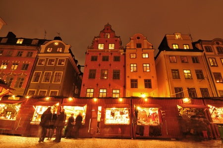 Stockholm, Sweden - 12 Dec, 2011: Tourists shopping at traditional Christmas market in Gamla Stan, the old town of Stockholm
