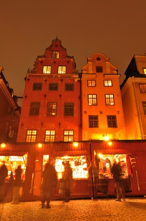 scandinavian christmas: Stockholm, Sweden - 12 Dec, 2011: Tourists shopping at traditional Christmas market in Gamla Stan, the old town of Stockholm