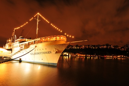 depart: Stockholm, Sweden - 12 Dec, 2011: Cruise ship ready to depart from Stockholm main pier at night  Editorial
