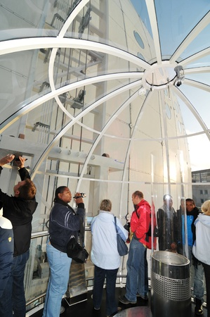 ericsson: Stockholm, Sweden - 15 Dec, 2011: Tourists taking pictures inside the capsule at Ericsson Globe, the national indoor arena of Sweden, located in the Johanneshov district of Stockholm