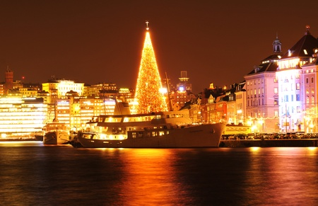 huge christmas tree: Stockholm, Sweden - 14 Dec, 2011: Night view of Stockholm quays at Christmas  Editorial