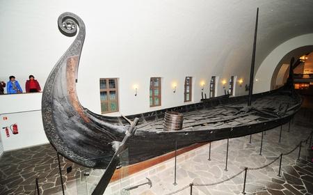 Vikings: Oslo, Norway - 18 Dec, 2011: Tourists visiting the Viking Ship Museum (Vikingskipshuset) in Oslo