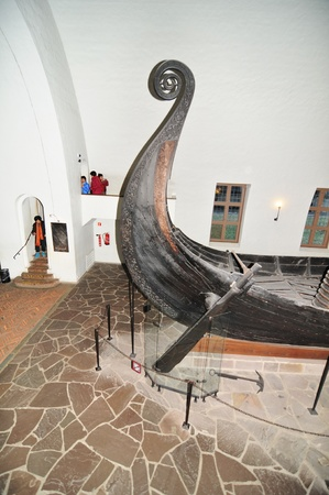 archaeologists: Oslo, Norway - 18 Dec, 2011: Tourists visiting the Viking Ship Museum (Vikingskipshuset) in Oslo