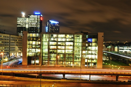 Oslo, Norway - 16 Dec, 2011: Modern architecture and night traffic in central Oslo