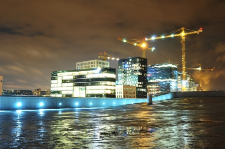 industrial site: Oslo, Norway - 16 Dec, 2011: Night view of modern city under construction