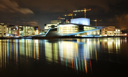 Oslo, Norway - 16 Dec, 2011: Night reflections of Opera House modern architecture in Oslo