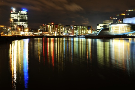 sea scape: Oslo, Norway - 16 Dec, 2011: Night reflections of modern architecture in Oslo Editorial
