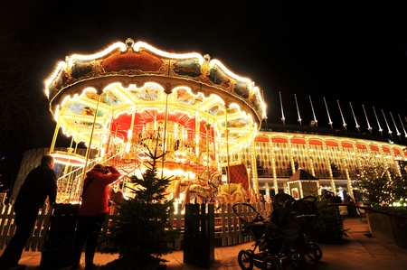 Copenhagen, Denmark - 19 Dec, 2011: Colorful carousel in Tivoli Gardens at night Stock Photo - 12160456