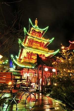 chinese lanterns: Copenhagen, Denmark - 19 Dec, 2011: Night view of Chinese restaurant pagoda in Tivoli Gardens