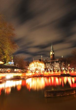 Copenhagen, Denmark - 19 Dec, 2011: Night scenery of City Hall in Copenhagen seen from the Tivoli Gardens at Christmas Stock Photo - 12160445