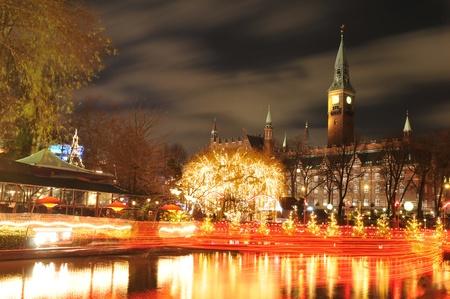 Copenhagen, Denmark - 19 Dec, 2011: Night scenery of City Hall in Copenhagen seen from the Tivoli Gardens at Christmas Editorial