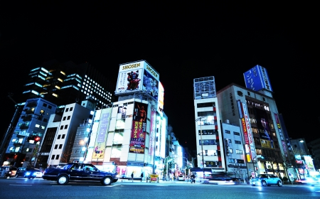 Tokyo, Japan - 27 Dec, 2011: Skyscrapers and colorful billboards in central Tokyo at night