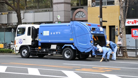 Tokyo, Japan - 28 Dec, 2011: Garbage truck and salubrity workers on the streets of Tokyo Stock Photo - 12445424