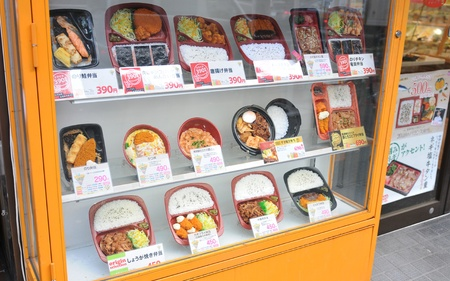 priced: Tokyo, Japan - 28 Dec, 2011: Assortments of tasty Japanese food displayed in restaurant window Editorial