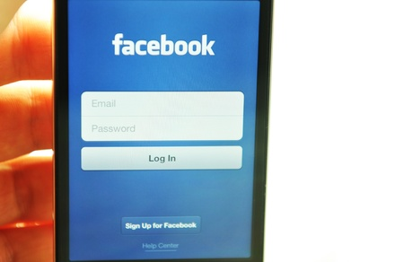 London, UK - 27 Feb, 2012: Social network concept with iPod and dedicated Facebook application
