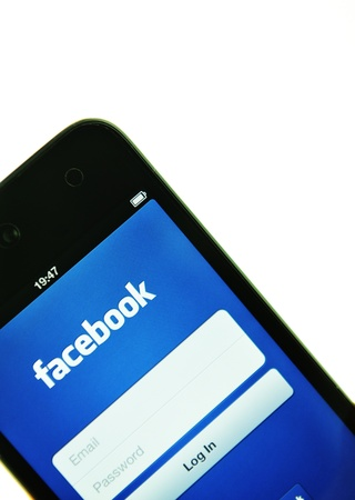 London, UK - 27 Feb, 2012: Social network concept with iPod and dedicated Facebook application Stock Photo - 12513288