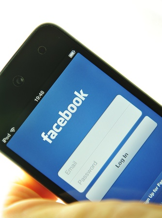 London, UK - 27 Feb, 2012: Social network with iPod and dedicated Facebook application Stock Photo - 12513294