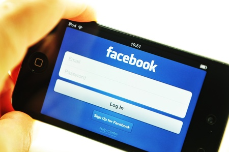 London, UK - 27 Feb, 2012: Social network concept with iPods and dedicated Facebook application Stock Photo - 12513292