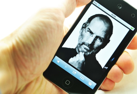 London, UK - 27 Feb, 2012: Steve Jobs, the co-founder of Apple Inc. depicted on iPod, created and marketed by Apple.