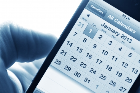London, UK - 27 Feb, 2012: Hand holding smartphone with calendar set on 1 January 2013