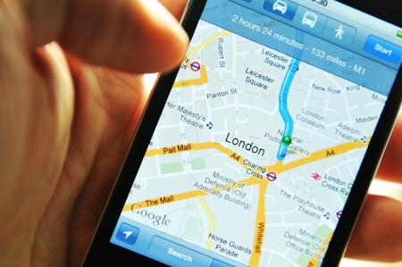 maps: London, UK - 27 Feb, 2012: Hand holding iPod displaying Google maps application