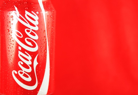 London, UK - 27 Feb, 2012: Coca Cola logo on refreshment can against red background